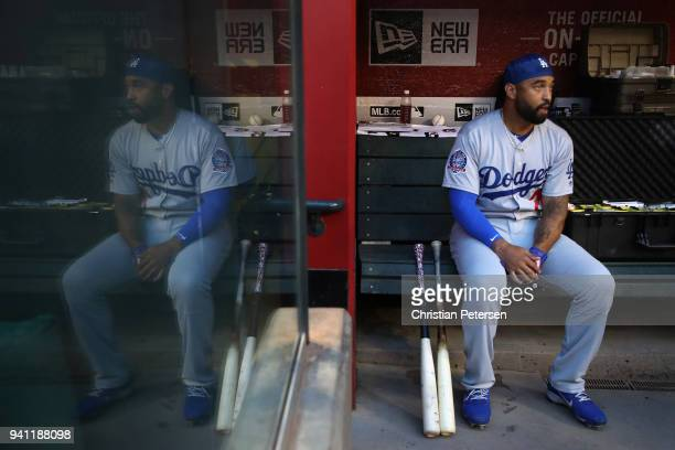 Matt Kemp of the Los Angeles Dodgers sits in the dugout before the MLB game against the Arizona Diamondbacks at Chase Field on April 2 2018 in...
