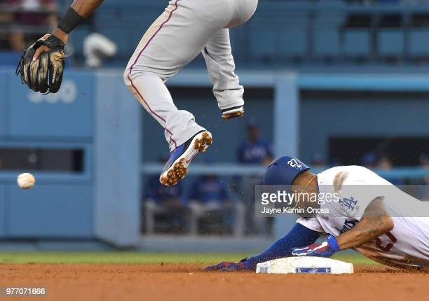 Matt Kemp of the Los Angeles Dodgers slides safe into second base in the third inning of the game against the Texas Rangers at Dodger Stadium on June...