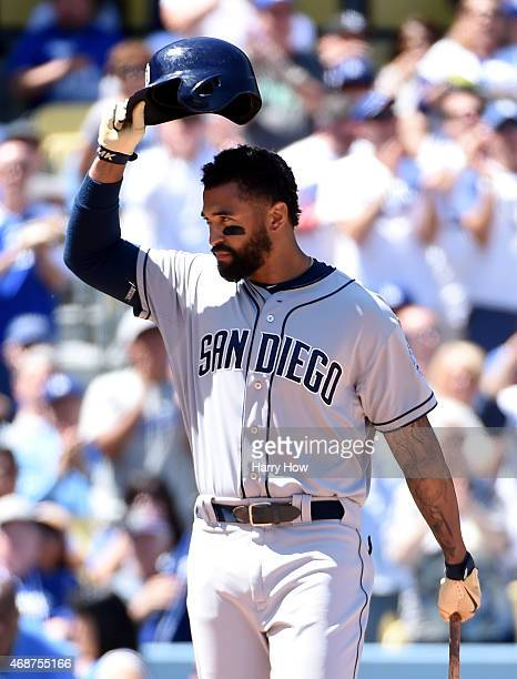 Matt Kemp of the San Diego Padres acknowledges applause at the batter's box before his at bat against the Los Angeles Dodgers during opening day at...