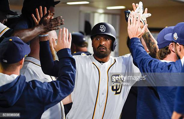 Matt Kemp of the San Diego Padres is congratulated after scoring during the sixth inning of a baseball game against the St Louis Cardinals at PETCO...