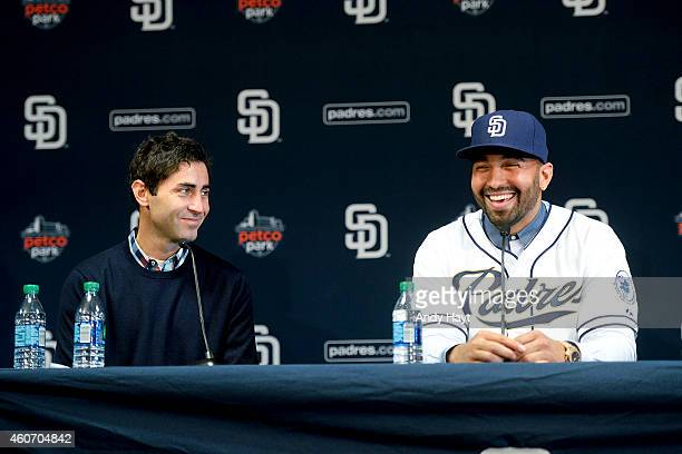 Matt Kemp smiles at General Manager AJ Preller of the San Diego Padres at a press conference introducing Kemp as the newest member of the Padres at...