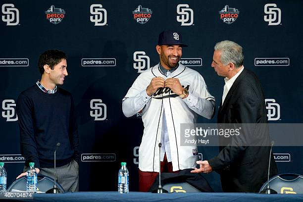 Matt Kemp smiles at Manager Bud Black and General Manager AJ Preller of the San Diego Padres at a press conference introducing Kemp as the newest...