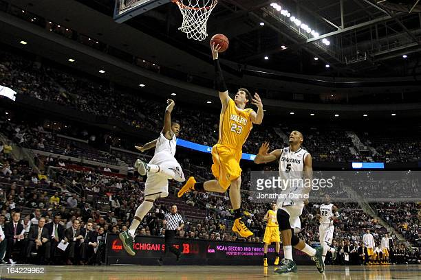 Matt Kenney of the Valparaiso Crusaders drives for a shot attempt in the first half against Adreian Payne of the Michigan State Spartans during the...