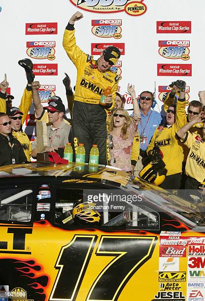 Matt Kenseth celebrates winning during the NASCAR Winston Cup Series Checker Auto Parts 500 on November 10 2002 at the Phoenix International Raceway...