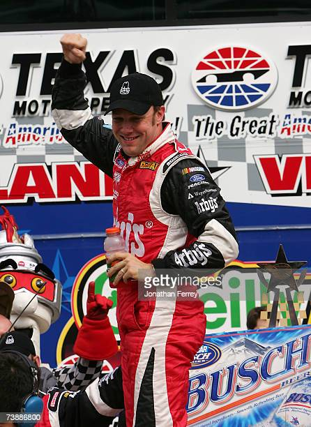 Matt Kenseth driver of the Arby's Ford celebrates in victory lane after winning the NASCAR Busch Series O'Reilly 300 at Texas Motor Speedway on April...