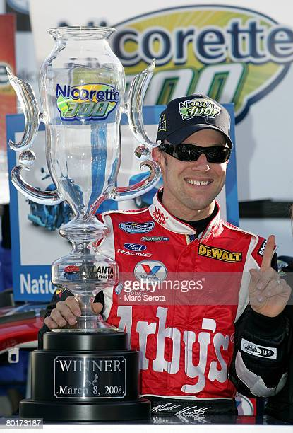 Matt Kenseth driver of the Arby's Ford celebrates in victory lane after winning the NASCAR Nationwide Series Nicorette 200 at the Atlanta Motor...