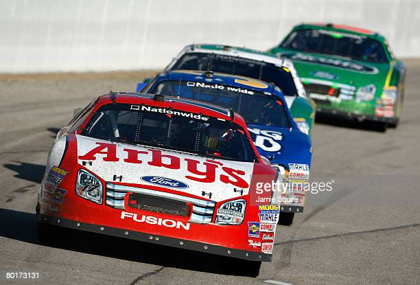 Matt Kenseth driver of the Arby's Ford leads Kevin Harvick driver of the Camping World Chevrolet during the NASCAR Nationwide Series Nicorette 200 at...