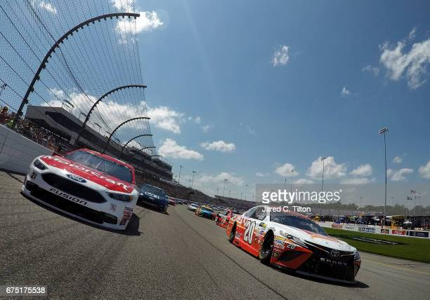 Matt Kenseth driver of the Circle K Toyota and Ryan Blaney driver of the Motorcraft/Quick Lane Tire Auto Center Ford lead the field under caution...