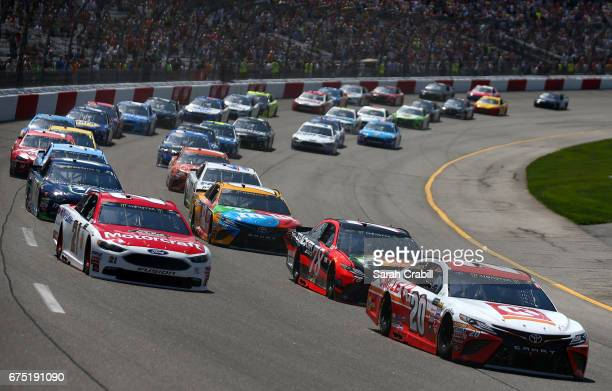 Matt Kenseth driver of the Circle K Toyota and Ryan Blaney driver of the Motorcraft/Quick Lane Tire Auto Center Ford lead the field into turn one to...