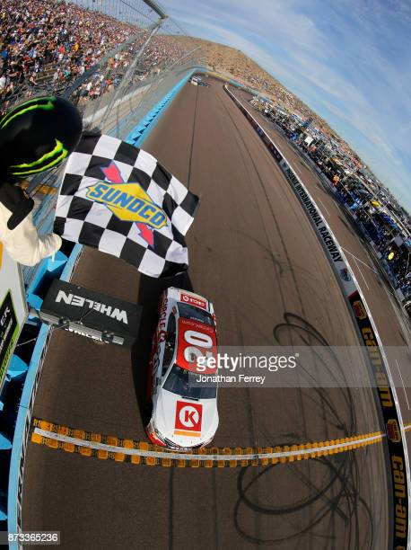 Matt Kenseth driver of the Circle K Toyota crosses the finish line to win the Monster Energy NASCAR Cup Series CanAm 500 at Phoenix International...