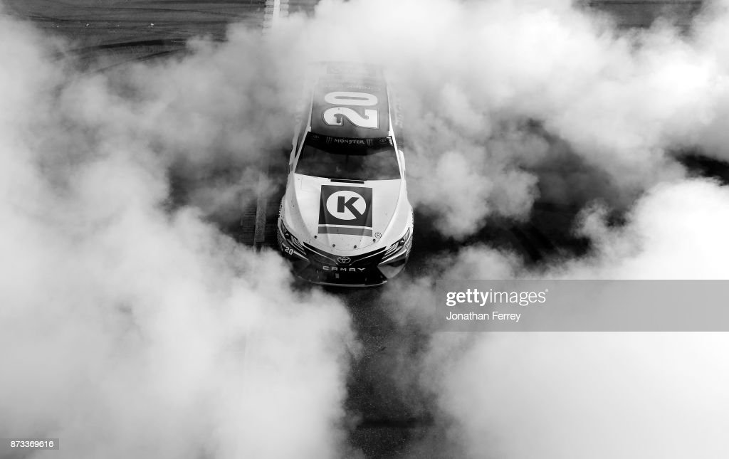 Matt Kenseth, driver of the #20 Circle K Toyota, does a burnout after winning the Monster Energy NASCAR Cup Series Can-Am 500 at Phoenix International Raceway on November 12, 2017 in Avondale, Arizona.