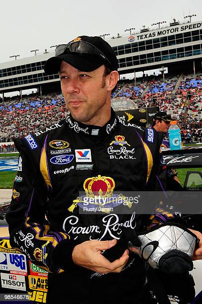 Matt Kenseth, driver of the Crown Royal Black Ford, looks on from the grid prior to the start of the NASCAR Sprint Cup Series Samsung Mobile 500 at...