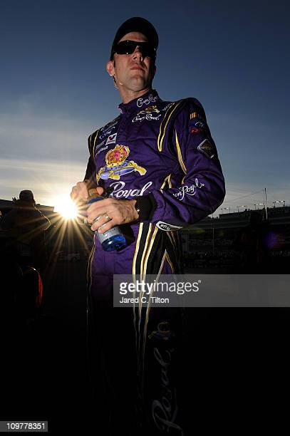 Matt Kenseth driver of the Crown Royal Ford stands in the garage area after qualifying for pole position in the NASCAR Sprint Cup Series Kobalt Tools...