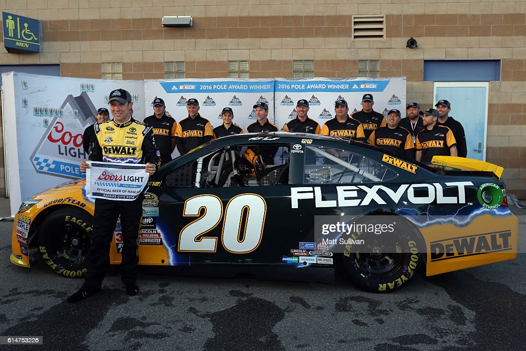 Matt Kenseth, driver of the #20 DEWALT FLEXVOLT Toyota, and his team pose with the Coors Light Pole Award after qualifying in the pole position for the NASCAR Sprint Cup Series Hollywood Casino 400 at Kansas Speedway on October 14, 2016 in Kansas City, Kansas.