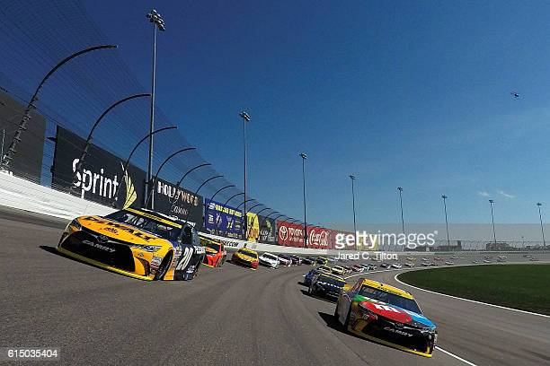 Matt Kenseth driver of the DEWALT FLEXVOLT Toyota and Kyle Busch driver of the MM's Toyota lead the field under caution prior to the start of the...
