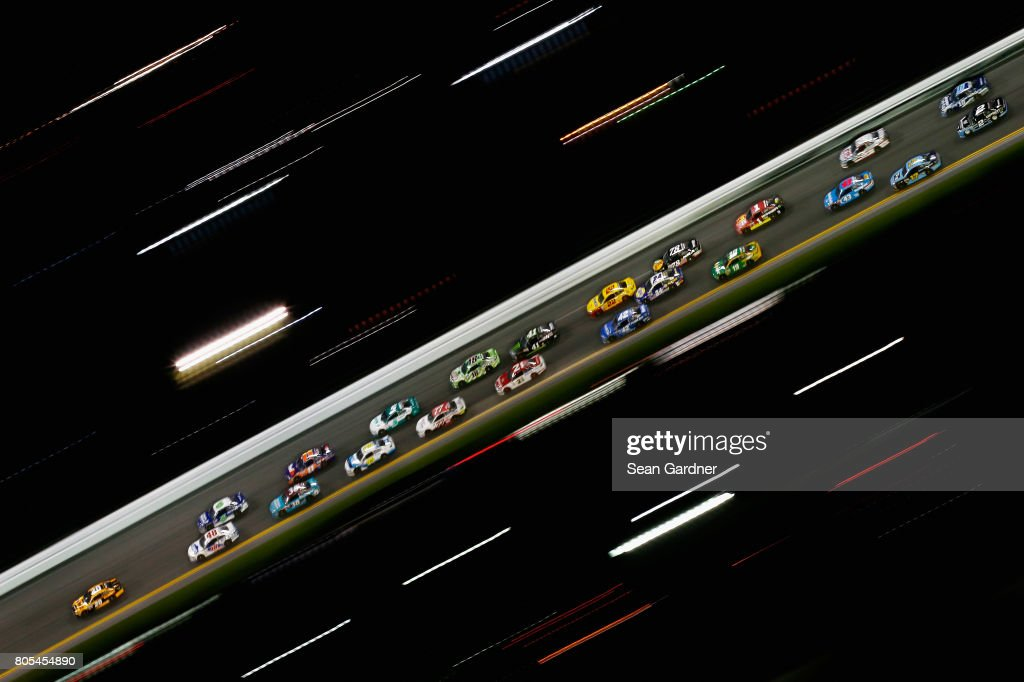 Matt Kenseth, driver of the #20 DEWALT Flexvolt Toyota, leads a pack of cars during the Monster Energy NASCAR Cup Series 59th Annual Coke Zero 400 Powered By Coca-Cola at Daytona International Speedway on July 1, 2017 in Daytona Beach, Florida.