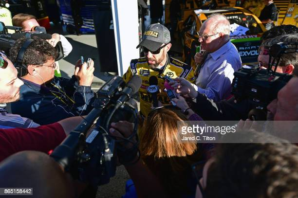 Matt Kenseth, driver of the DeWalt Flexvolt Toyota, talks to the media after being disqualified during the Monster Energy NASCAR Cup Series Hollywood...