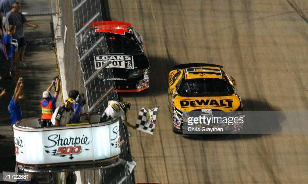 Matt Kenseth driver of the DeWalt Ford crosses the finish line to win the NASCAR Nextel Cup Series Sharpie 500 on August 26 2006 at Bristol Motor...