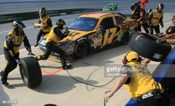Matt Kenseth, driver of the DeWalt Ford, makes a pit stop during the NASCAR Sprint Cup Series Amp Energy 500 at Talladega Superspeedway on October 5,...