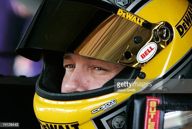 Matt Kenseth, driver of the DeWalt Ford, sits in his car during practice for the NASCAR Nextel Cup Series Dodge Avenger 500 on May 11, 2007 at...