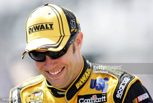 Matt Kenseth, driver of the DeWalt Ford, smiles while walking on pit road during qualifying for the NASCAR Nextel Cup Series Dodge Avenger 500 on May...