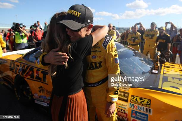 Matt Kenseth driver of the DeWalt Hurricane Relief Toyota hugs Amy Earnhardt prior to the Monster Energy NASCAR Cup Series Championship Ford EcoBoost...