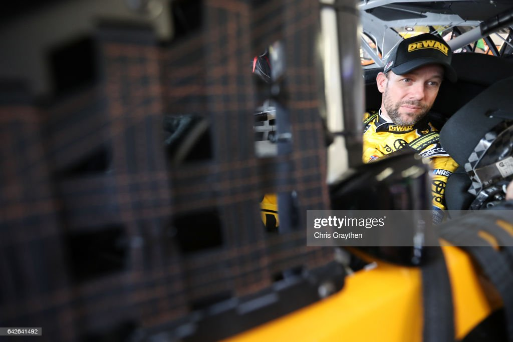 Matt Kenseth, driver of the #20 DeWalt Toyota, sits in his car during practice for the Monster Energy NASCAR Cup Series 59th Annual DAYTONA 500 at Daytona International Speedway on February 18, 2017 in Daytona Beach, Florida.