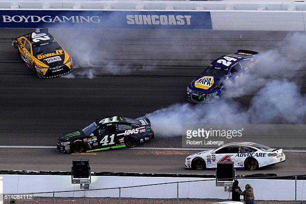 Matt Kenseth driver of the DeWalt Toyota spins along with Kurt Busch driver of the Monster Energy / Haas Automation Chevrolet and Chase Elliott...