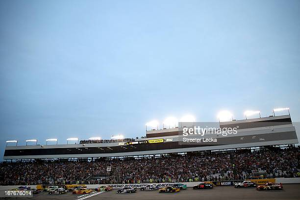 Matt Kenseth driver of the Dollar General Toyota and Brian Vickers driver of the FedEx Delivery Manager Toyota lead the field to start the NASCAR...