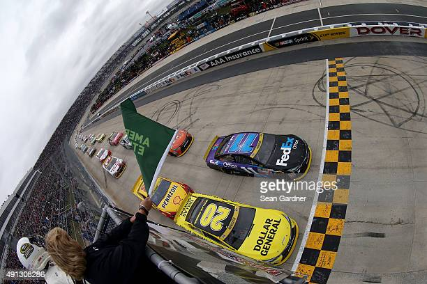 Matt Kenseth driver of the Dollar General Toyota and Denny Hamlin driver of the FedEx Office Toyota lead the field to the green flag to start the...