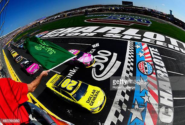 Matt Kenseth, driver of the Dollar General Toyota, and Kyle Busch, driver of the M&M's Pretty In Pink Foundation Toyota, lead the field to the green...