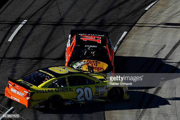 Matt Kenseth driver of the Dollar General Toyota and Tony Stewart driver of the Bass Pro Shops / Mobil 1 Chevrolet are involved in an incident during...