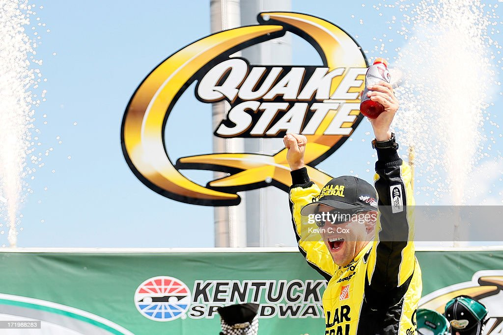 Matt Kenseth, driver of the #20 Dollar General Toyota, celebrates in Victory Lane after winning the NASCAR Sprint Cup Series Quaker State 400 at Kentucky Speedway on June 30, 2013 in Sparta, Kentucky.