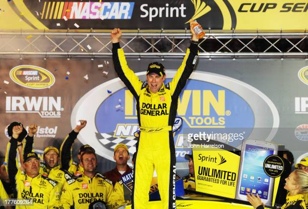 Matt Kenseth driver of the Dollar General Toyota celebrates in Victory Lane after winning the NASCAR Sprint Cup Series 53rd Annual IRWIN Tools Night...