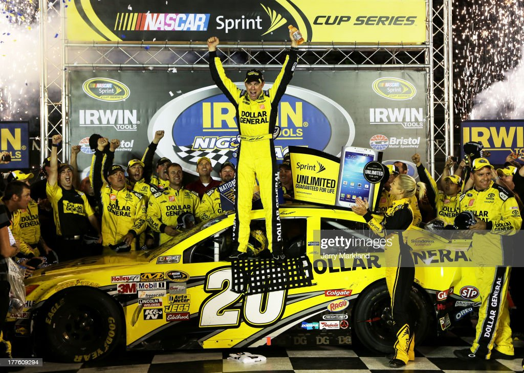 Matt Kenseth, driver of the #20 Dollar General Toyota, celebrates in Victory Lane after winning the NASCAR Sprint Cup Series 53rd Annual IRWIN Tools Night Race at Bristol Motor Speedway on August 24, 2013 in Bristol, Tennessee.