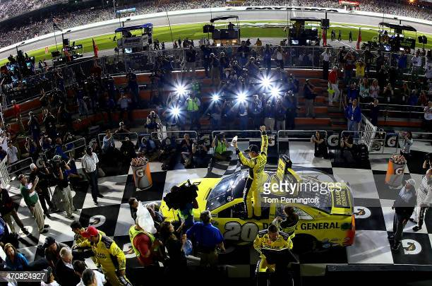 Matt Kenseth driver of the Dollar General Toyota celebrates in Victory Lane after winning the NASCAR Sprint Cup Series Budweiser Duel 1 at Daytona...