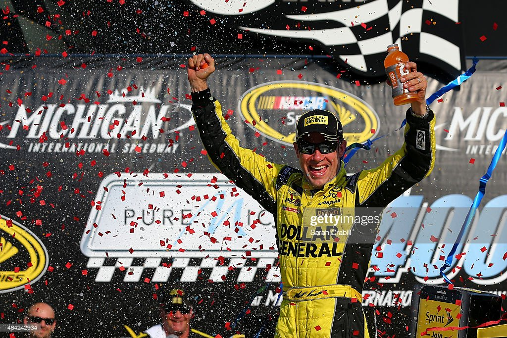 Matt Kenseth, driver of the #20 Dollar General Toyota, celebrates in victory lane after winning the NASCAR Sprint Cup Series Pure Michigan 400 at Michigan International Speedway on August 16, 2015 in Brooklyn, Michigan.