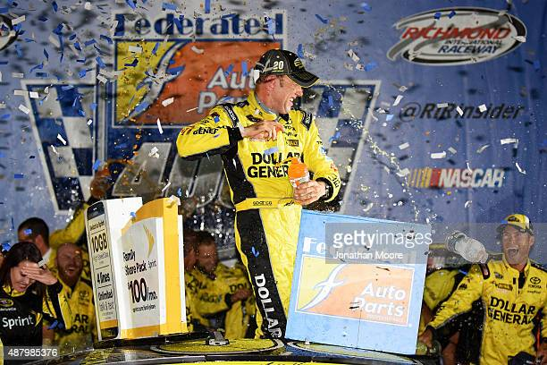 Matt Kenseth, driver of the Dollar General Toyota, celebrates in Victory Lane after winning the NASCAR Sprint Cup Series Federated Auto Parts 400 at...