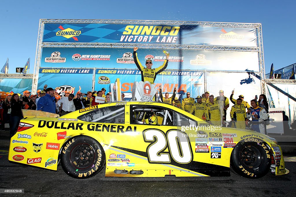 Matt Kenseth, driver of the #20 Dollar General Toyota, celebrates in Victory Lane after winning the NASCAR Sprint Cup Series SYLVANIA 300 at New Hampshire Motor Speedway on September 27, 2015 in Loudon, New Hampshire.