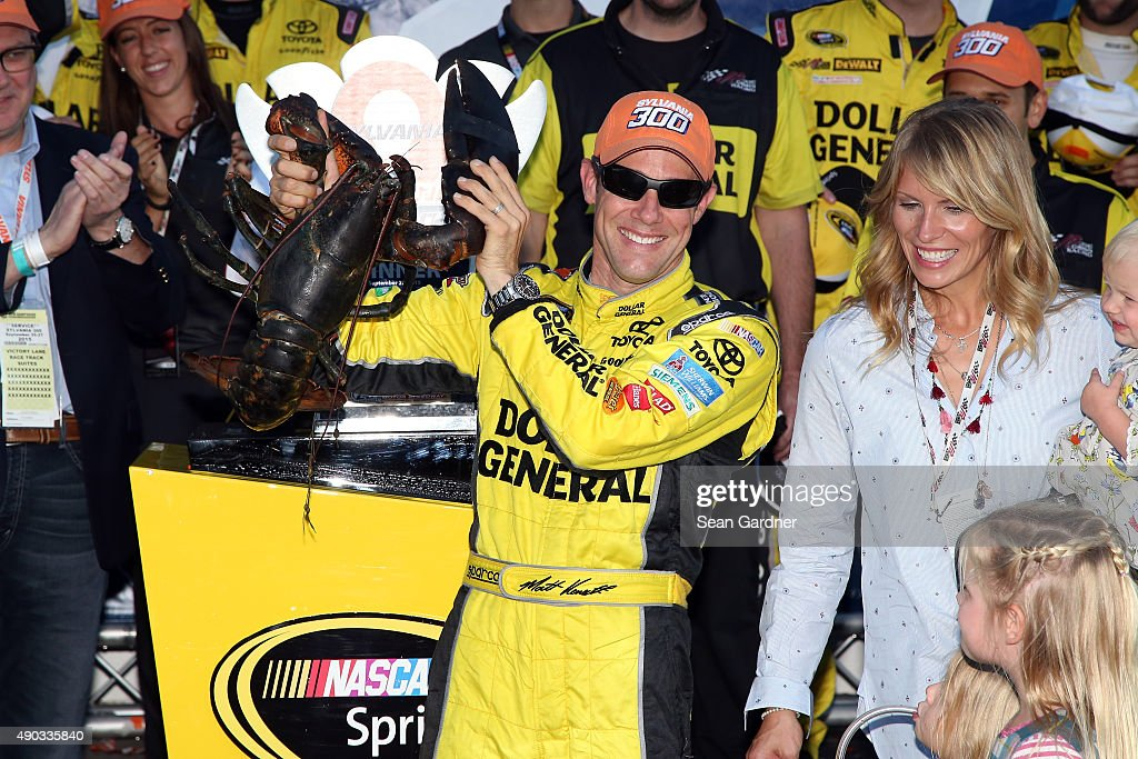 Matt Kenseth, driver of the #20 Dollar General Toyota, celebrates in Victory Lane with a lobster after winning the NASCAR Sprint Cup Series SYLVANIA 300 at New Hampshire Motor Speedway on September 27, 2015 in Loudon, New Hampshire.