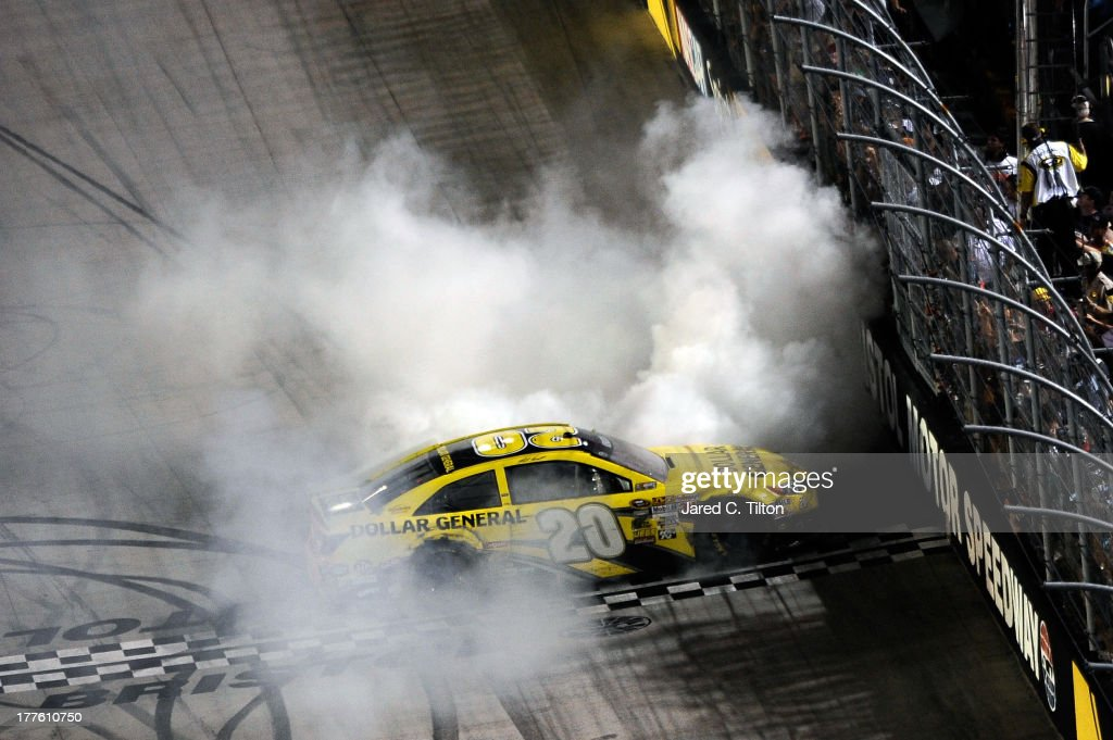 Matt Kenseth, driver of the #20 Dollar General Toyota, celebrates with a burnout after winning the NASCAR Sprint Cup Series 53rd Annual IRWIN Tools Night Race at Bristol Motor Speedway on August 24, 2013 in Bristol, Tennessee.