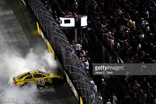 Matt Kenseth driver of the Dollar General Toyota celebrates with a burnout after winning the NASCAR Sprint Cup Series 53rd Annual IRWIN Tools Night...