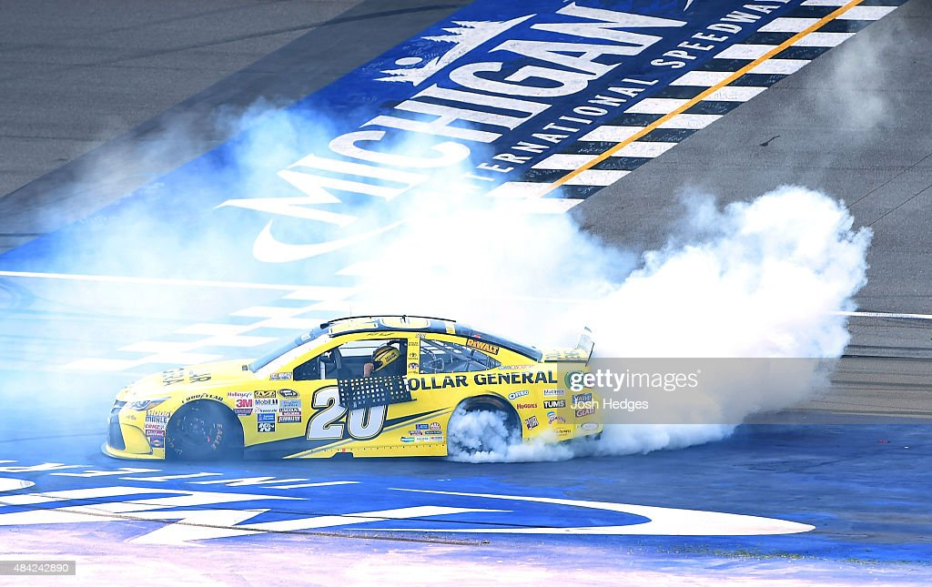 Matt Kenseth, driver of the #20 Dollar General Toyota, celebrates with a burnout after winning the NASCAR Sprint Cup Series Pure Michigan 400 at Michigan International Speedway on August 16, 2015 in Brooklyn, Michigan.