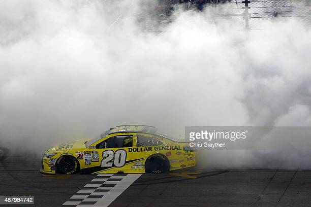 Matt Kenseth driver of the Dollar General Toyota celebrates with a burnout after winning the NASCAR Sprint Cup Series Federated Auto Parts 400 at...