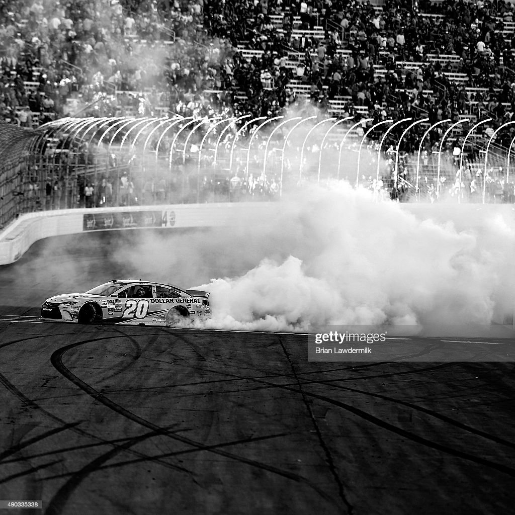 Matt Kenseth, driver of the #20 Dollar General Toyota, celebrates with a burnout after winning the NASCAR Sprint Cup Series SYLVANIA 300 at New Hampshire Motor Speedway on September 27, 2015 in Loudon, New Hampshire.