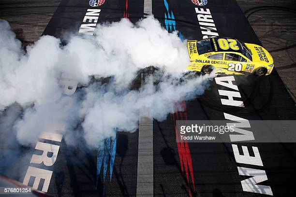 Matt Kenseth, driver of the Dollar General Toyota, celebrates with a burnout after winning the NASCAR Sprint Cup Series New Hampshire 301 at New...