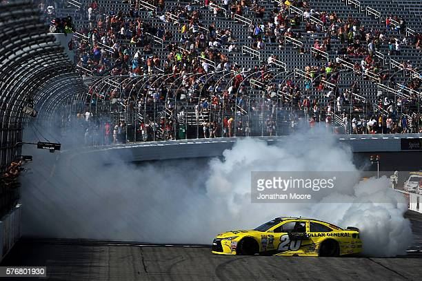 Matt Kenseth driver of the Dollar General Toyota celebrates with a burnout after winning the NASCAR Sprint Cup Series New Hampshire 301 at New...