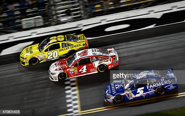 Matt Kenseth driver of the Dollar General Toyota croesses the finishline to win the NASCAR Sprint Cup Series Budweiser Duel 1 in front of Kevin...