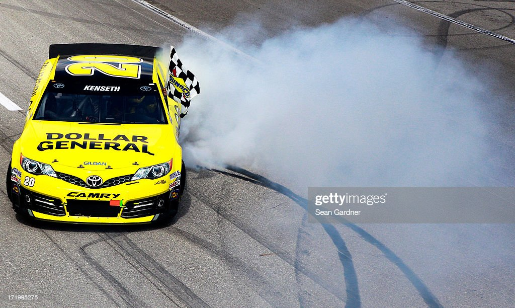 Matt Kenseth, driver of the #20 Dollar General Toyota, does a burnout after winning the NASCAR Sprint Cup Series Quaker State 400 at Kentucky Speedway on June 30, 2013 in Sparta, Kentucky.