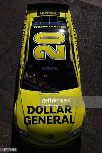 Matt Kenseth driver of the Dollar General Toyota drives through the garage area during practice for the NASCAR Sprint Cup Series AdvoCare 500 at...